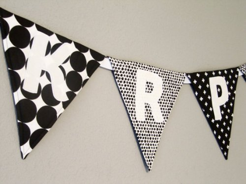 A bit of personalised bunting is a must-have in a modern day nursery. Or not. Your choice.