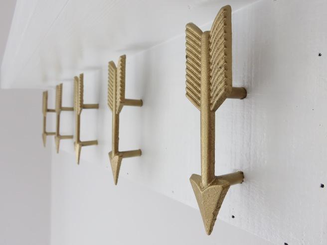 Gold arrow nursery hooks